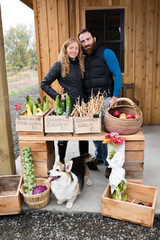 Portrait of mid adult couple at organic farm shop