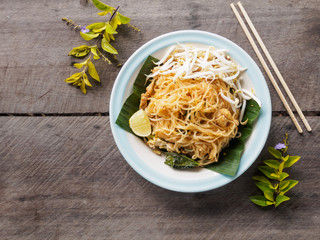 Fried noodles (Pad Thai) on wooden table, Thai food style