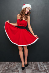 Girl with Santa hats dancing in a red dress