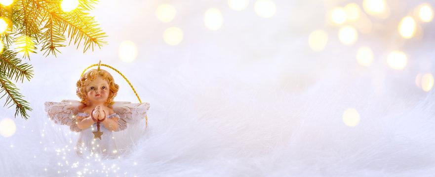 Christmas background with Christmas tree and Christmas angel