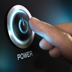 Finger Pressing Power Button on a Computer