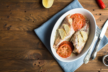 Baked sea bass with tomatoes and lemon