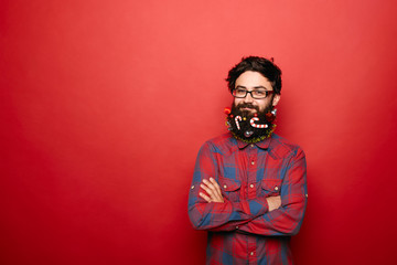 Young man with Christmas decorated beard