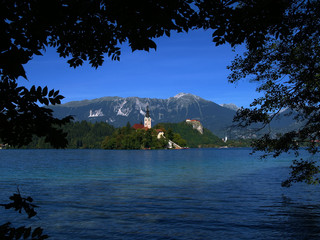 Wall Mural - Lake Bled with its Island Church on a bright summer day.