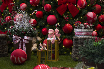 Christmas decoration with balls, flowers, baskets, tree with lig