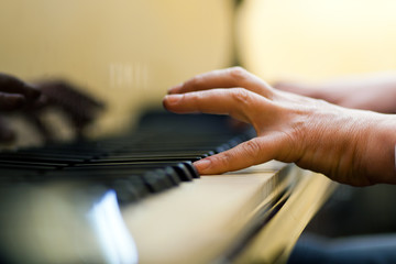 Male hand playing the piano