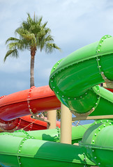 Colorful water slides in waterpark resort.