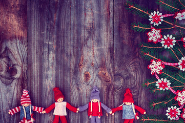 Vintage wooden Christmas background with rag dolls