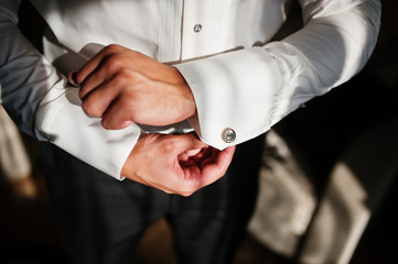 Man wearing luxury cufflinks  on shirt. Gathering of groom on we