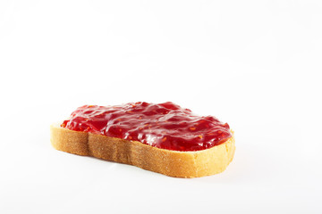 Sandwich of white bread and raspberry jam on an isolated background