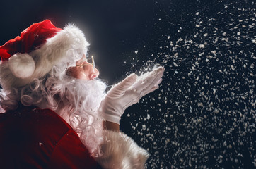 Santa Claus blows snow. Wall mural
