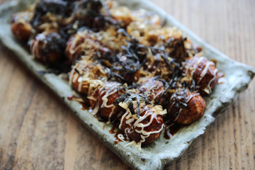 Takoyaki on wood background , japanese food