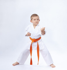 In the rack of karate is standing a small athlete