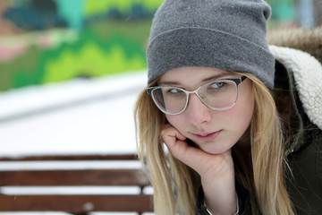 Pensive teenager on bench