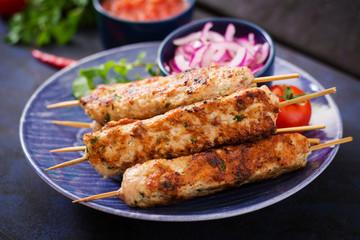Minced Lula kebab grilled turkey (chicken) on plate.