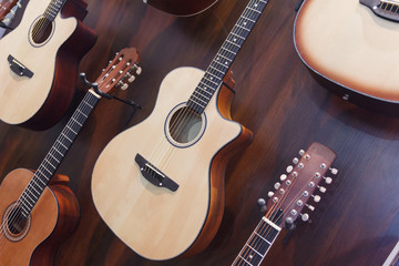 Classical acoustic guitars in musical store. Music