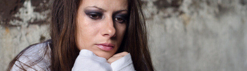 Depressed young girl, alcohol or drug addict lost in thoughts