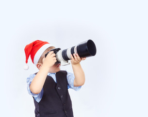 Little photographer is photographing on camera