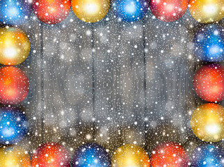 New year theme: christmas decor with balls on retro stylized wood background with shiny snowfall