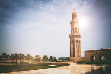 Sun shines behind tall religious monument
