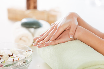 Woman in Spa Enjoying French Manicure.