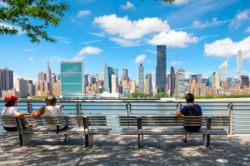 NewYorkers at a park in Queens with a view of the midtown Manhattan skyline
