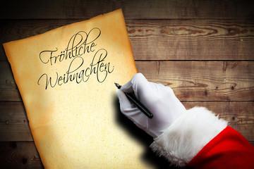 """Weihnachtsmann beginnt einen Brief mit der Überschrift """"Fröhliche Weihnachten"""""""