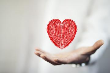 man hand heart