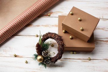 Christmas decoration and gift boxes over wooden background.