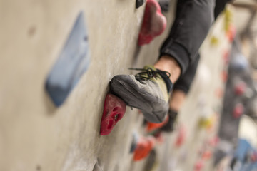 climbing shoes in boulder climbing hall