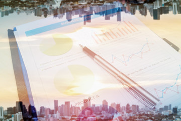 Double exposure of business report and city