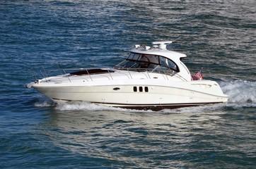 Up scale cabin cruiser on the florida intra-coastal waterway near Miami Beach,Florida