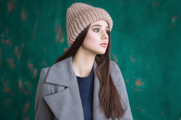 hipster girl with long brown hair wearing a stylish coat