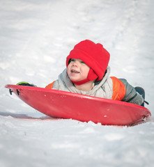 Young Child Sleigh Riding