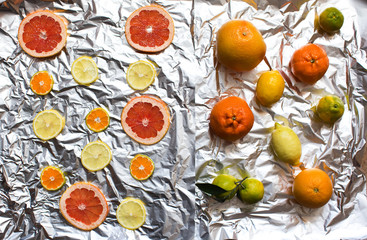 Citrus fruit whole and sliced.