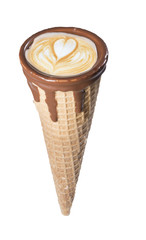Coffee in waffle ice cream cone with latte art in the milk foam, isolated, close up