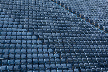 Photo sur Toile Stade de football Rows of blue plastic seats at football / soccer stadium.