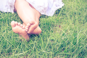 Woman legs lying on grass
