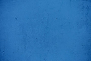 Textures on the blue wall, for background.