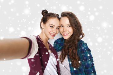 happy smiling pretty teenage girls taking selfie