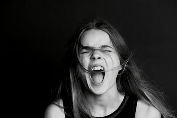 Beautiful girl with long hair yells. Black-white