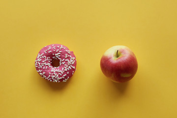 Apple and donut in the middle of picture.