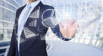Businessman touching technology interface with business and fina