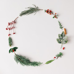 Christmas round frame made of natural winter things.