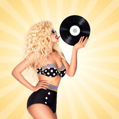 Taste and listen / Beautiful pinup bikini model, licking LP microgroove vinyl record on colorful abstract cartoon style background.