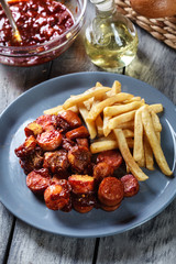 Traditional German currywurst - pieces of sausage with curry sau
