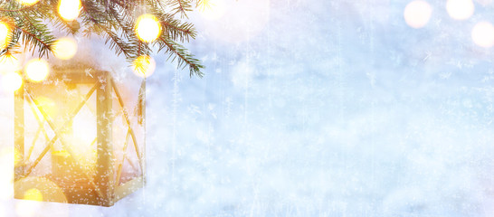 Snow Christmas tree and Holidays light on blue winter background