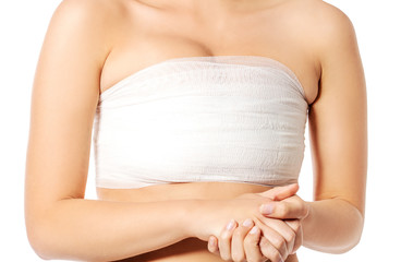 Elastic breast of a pretty woman, isolated, white background.