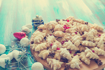 Festive cookies on turquoise wooden table