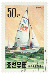 Sailing yacht on postage stamp
